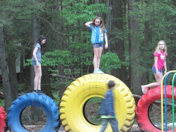 Kids playing on the playground at Rip Van Winkle Campgrounds in the Catskills