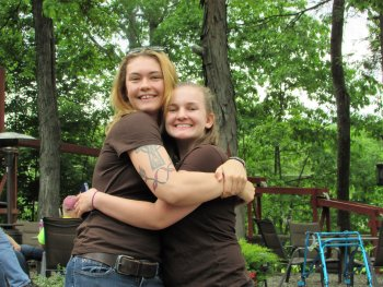 Two young female campers hugging and posing for a photo art Rip Van Winkle Campgrounds