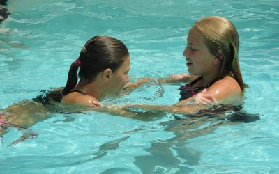 two girls swimming in the pool at Rip Van Winkle Campgrounds located in the Catskills NY