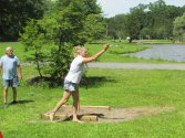 Woman Playing Horseshoes