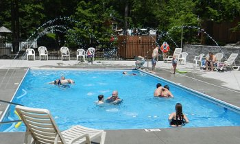 People enjoying some time in the pool at Rip Van Winkle Campgrounds